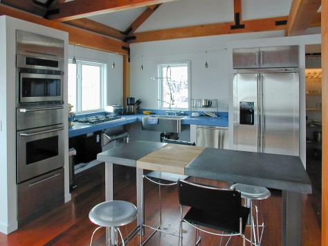 Kitchen showing blue concrete countertops